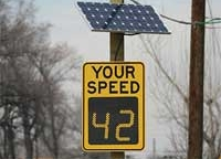 a sign displaying a driver's speed using radar