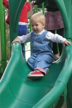 child using the slide